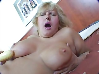 bulky blond mature masturbation on couch